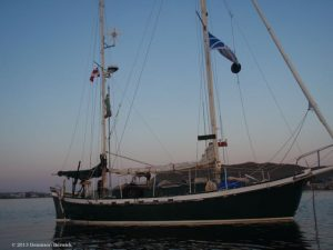 "My second sailboat ""SV Kuan Yin"", a 32-foot Tahitiiana, at anchor in St. Anthony, northern Newfoundland in 2013"