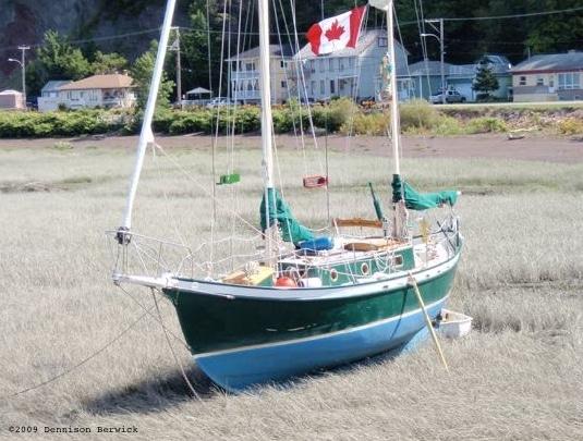 SV Kuan Yin in grass bay, Quebec